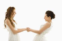 Bride pulling another bride. Stock Photos