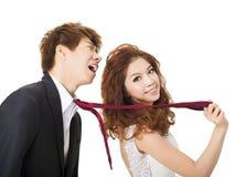 Bride pulling on groom tie Stock Photo