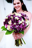 Bride with Purple and White Bouquet Royalty Free Stock Images