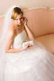 Bride and purse Royalty Free Stock Photo