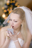 Bride put on rouge. Beautiful bride put on rouge royalty free stock photo