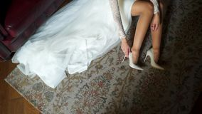 Bride put on shoes. Bride put on her shoes stock video footage
