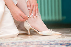 A bride puting on a shoe. Detail of a bride puting on a shoe Royalty Free Stock Photo