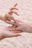 Bride Puts Ring On Groom - Beach Wedding Royalty Free Stock Photography