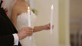 Bride puts a ring to grooms hand stock footage