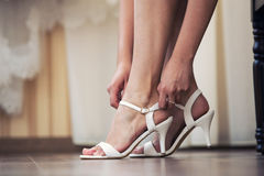 The bride puts on shoes  feet Stock Photos