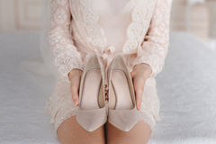 Bride puts on shoes. The bride`s fees. Bride puts on shoes Stock Images