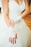 Bride puts on wedding gloves Stock Photo