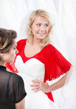 Bride puts the wedding gown to Stock Image