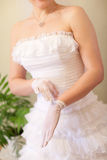Bride puts on a white glove Stock Images