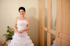 Bride puts on a white glove Royalty Free Stock Photo