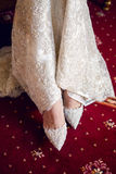Bride puts White shoes for wedding Stock Image