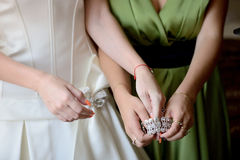 Bride is putting on the bracelet - stock photo Stock Image