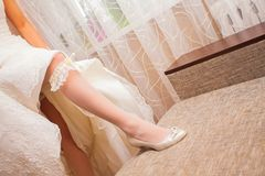Bride putting a garter Stock Photography