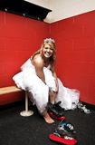 Bride putting on ice skates royalty free stock photography