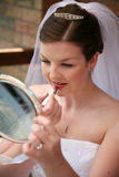 Bride putting lipstcik Stock Image