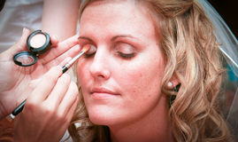 Bride Putting on Makeup Stock Images