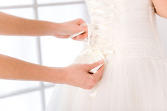 Bride putting white wedding dress Royalty Free Stock Photography