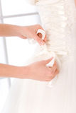 Bride putting white wedding dress Royalty Free Stock Photos
