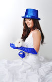 Bride with a rabbit in a blue hat and blue gloves Stock Images