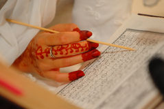 Bride reading Quran Royalty Free Stock Images