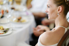 Bride at the reception table Royalty Free Stock Image