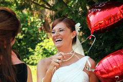 Bride with red balloons stock image