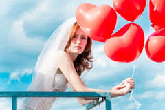 Bride with red balloons in lingerie Stock Photos