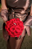 Bride Red Bouquet Bronze Gown stock photo