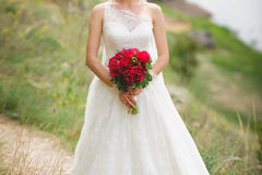 Bride with Red Bouquet Royalty Free Stock Images