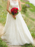 Bride with Red Bouquet Stock Photo