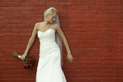 Bride on red brick wall Royalty Free Stock Photo