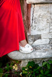 Bride in red dress and white shoes. Royalty Free Stock Photography