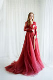 Bride in an red gown with calla flower in hands Royalty Free Stock Images