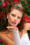 Bride in the Red Roses Royalty Free Stock Image