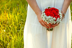 Bride with Red Roses. Bridal Bouquet with Red Roses Royalty Free Stock Photography