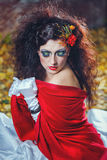 Bride with red shawl. Attractive bride in a wedding dress with bright makeup, red shawl Stock Image