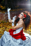Bride with red shawl. Attractive bride in a wedding dress with bright makeup, red shawl Royalty Free Stock Photos
