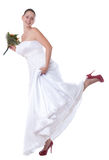 Bride with red shoes Royalty Free Stock Photos