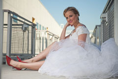 Bride with red shoes Royalty Free Stock Image