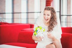 Bride red sofa Stock Images
