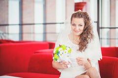 Bride red sofa Stock Image