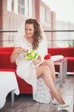 Bride red sofa Royalty Free Stock Photos