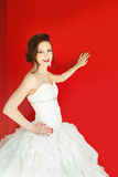 Bride and red wall Royalty Free Stock Photography