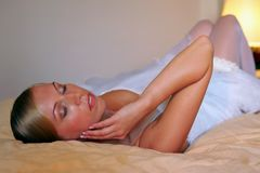 Bride relaxing on bed Stock Photos