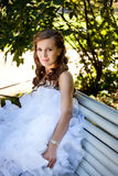 Bride relaxing in the park Royalty Free Stock Photo