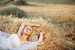 Free Bride Resting In Hay Stack Stock Image - 10899411