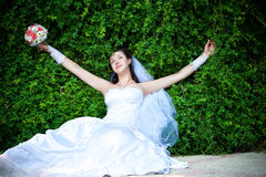 Bride is resting  with outstretched arms Stock Photography