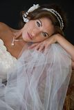 Bride Rests Head on Hand Stock Photo