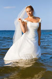 Bride in the river Stock Photo